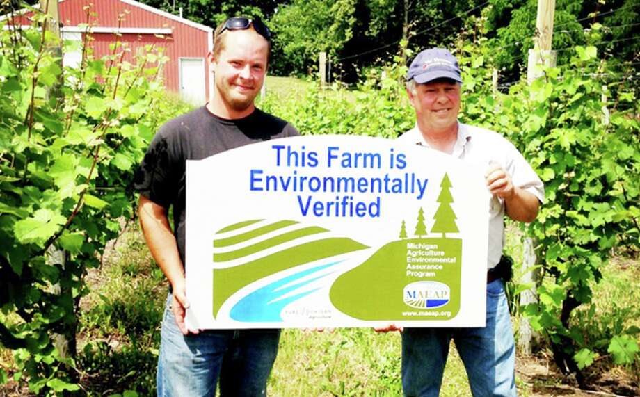 VERIFIED: Mike and Mark Evans of Evans Brothers Fruit Company MAEAP certification sign, which shows their dedication topreserving integrity of the land they are growing on for future generations.(Courtesy photo)