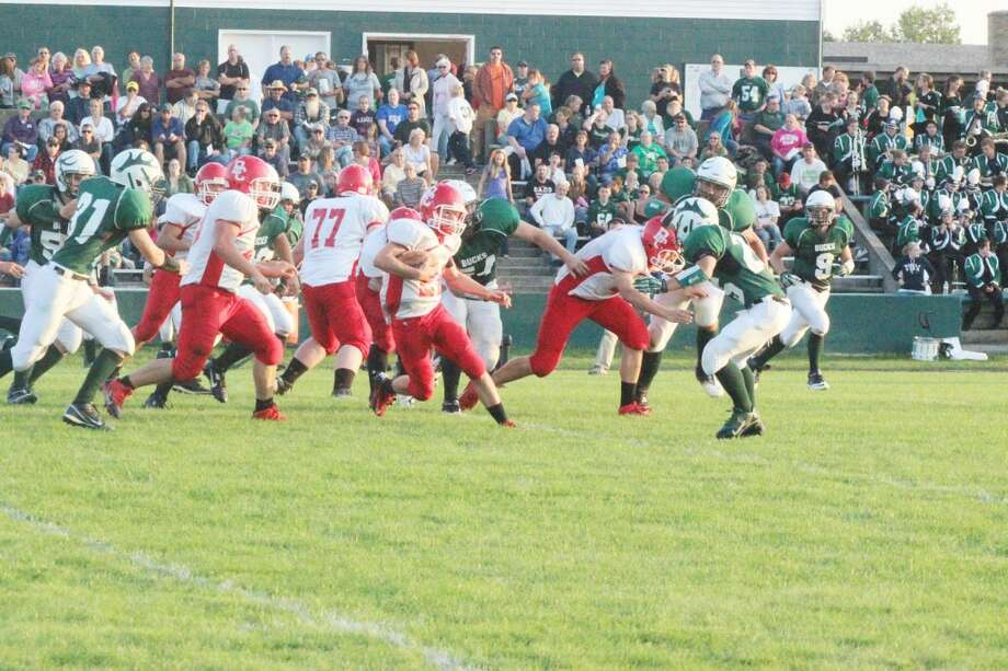 BALL CARRIER: Chase Buist (21) carries the ball while his line blocks. The Huskies rushed for over 200 yards during the game at Pine River, showing a lot of offensive potential. (Photo/Bryan Warrick)