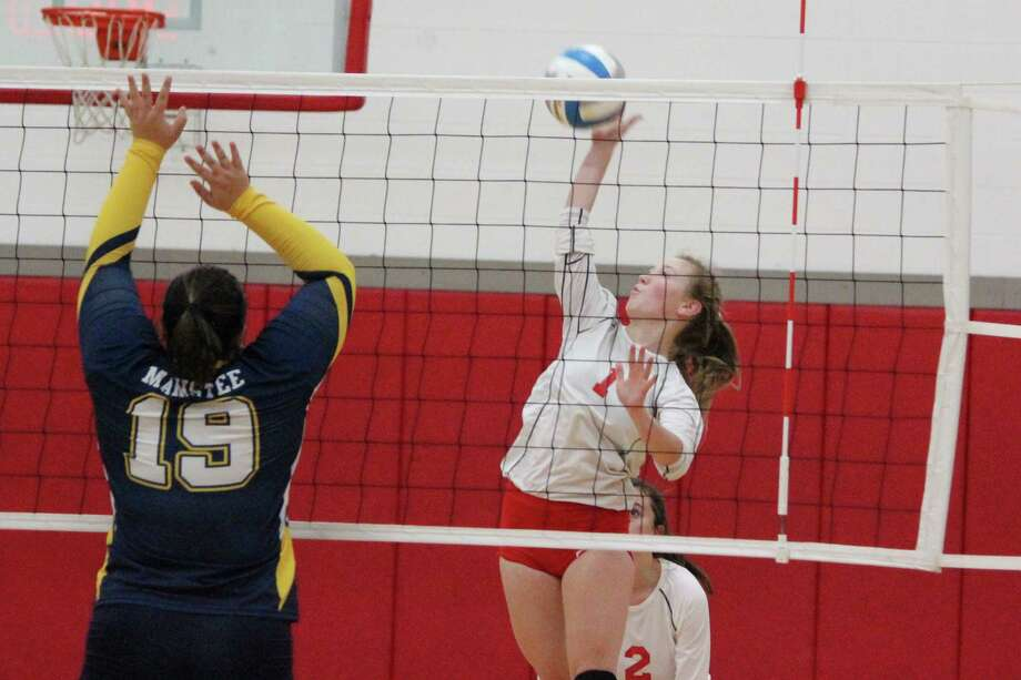 Kelsey Novogradac swings for a kill at the net against Manistee. (Photo/Robert Myers)