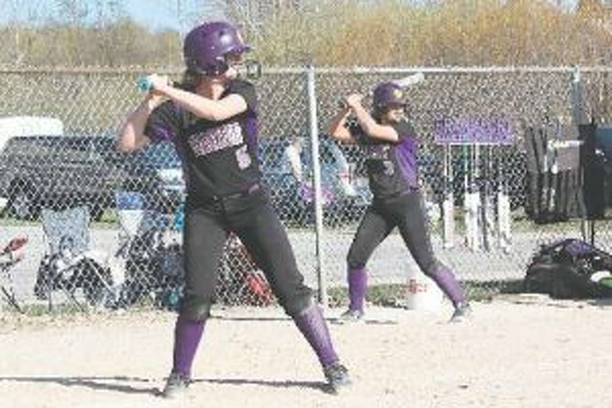 First team all-state shortstop Haley Myers waits on a pitch, while honorable mention all-state second baseman Bre Dawe waits on deck. (File photo)