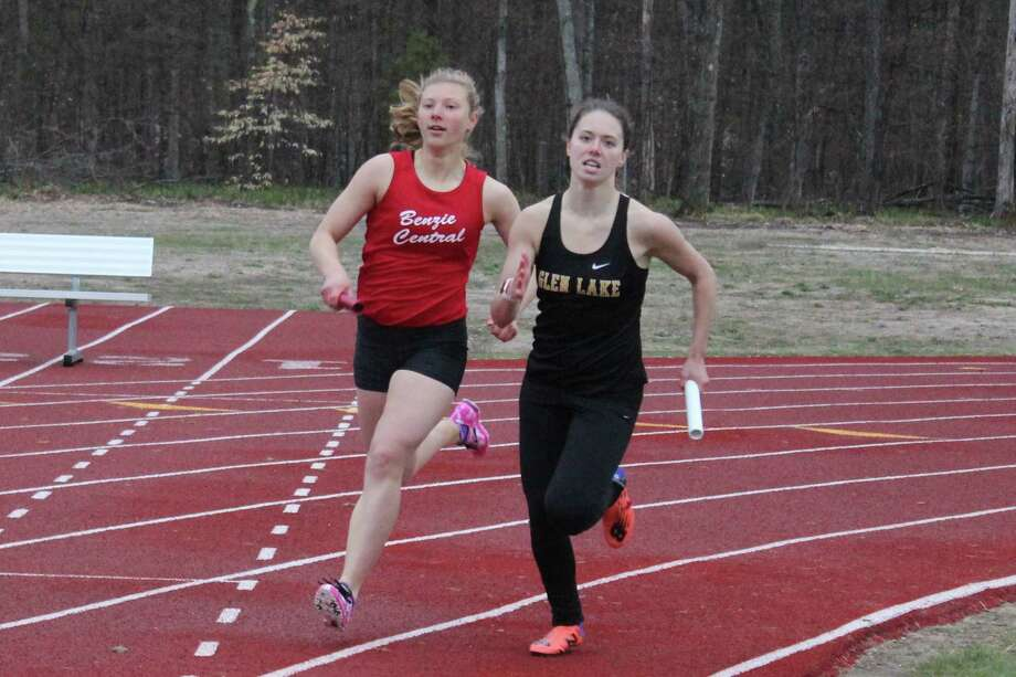 Sierra Pallin comes around the corner ready to surge past her foe from Glen Lake to win the 4x400-meter relay for her team. (Photo/Robert Myers)
