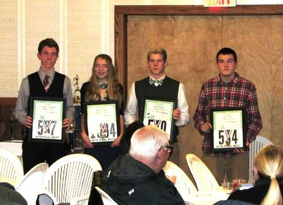 ALL STATE HUSKIES: The Benzie Central runners who earned all state show their medals and certificates. The runners are (from left) Brayden Huddleston, Stephanie Schuab, Jake Williams and Kyle Bailey. (Courtesy Photo)