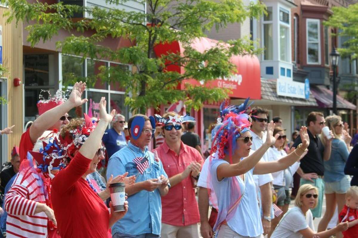 GOOD TIMES: Visitors to the Frankfort Fourth of July Parade don festive clothing and cheer on the parade, which featured emergency vehicles and floats created by area businesses and organizations.