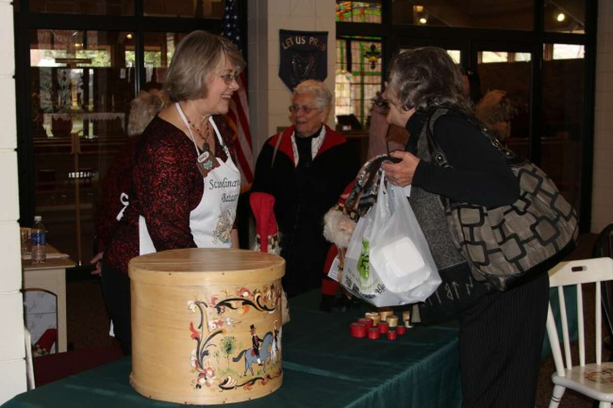 TRADITION: Many of the items for sale at the Scandinavian Bazaar and Luncheon are hand-crafted by the members of the Trinity Lutheran Church using traditional Scandinavian techniques, such as rosemauling. Included in the items fore sale were traditional Scandinavian Christmas decorations, such as paper trees, decorated elves and festive centerpieces.