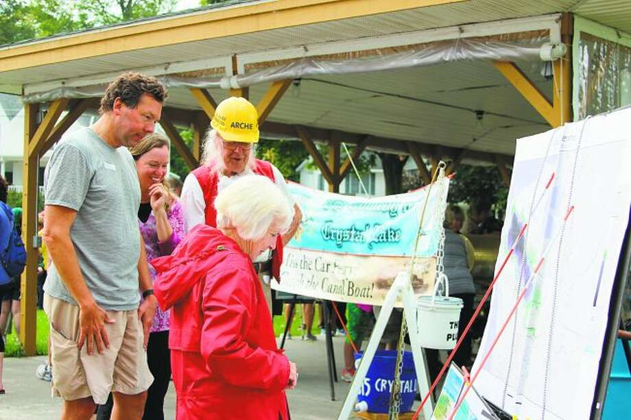 Archibald Jones (Stacy Daniels) talks to participants of the Cold Creek Bridge Walk about the history of Crystal Lake, including the story of Jones and his project that lowered the lake levels drastically. (File Photo)