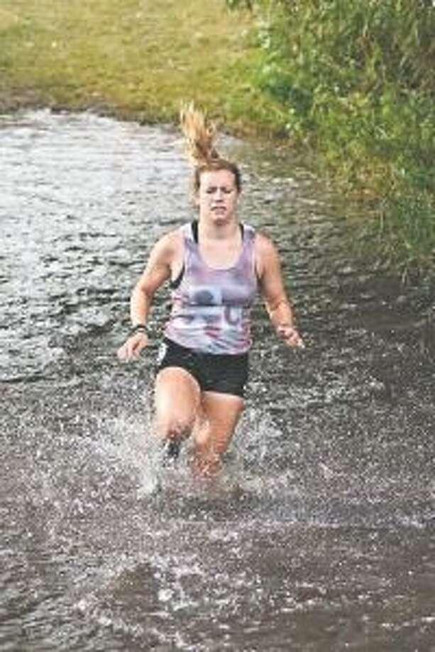 Savannah Rogers races through the mud run course at Charleviox. (Courtesy photo)