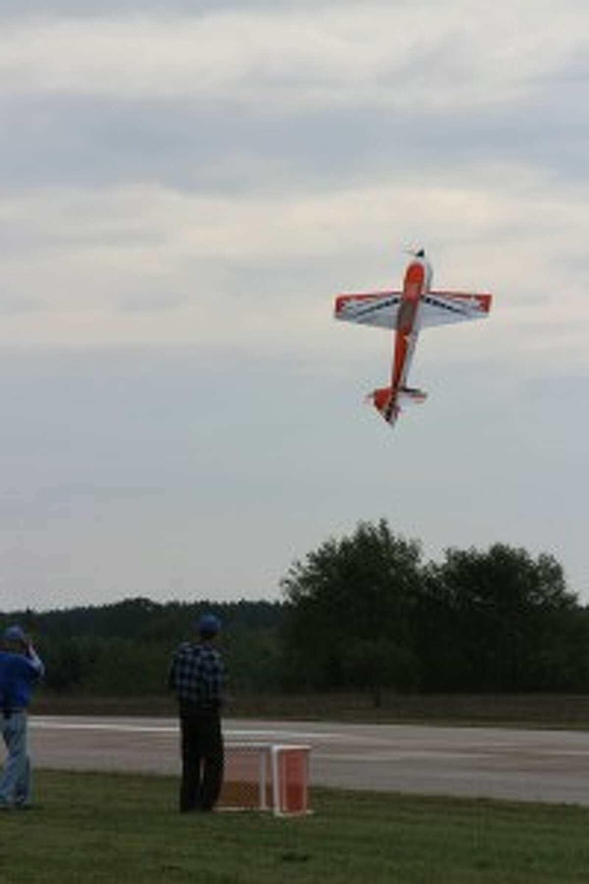 """TRICKY: A pilot makes his model plan hover, a trick called """"prop hanging""""."""