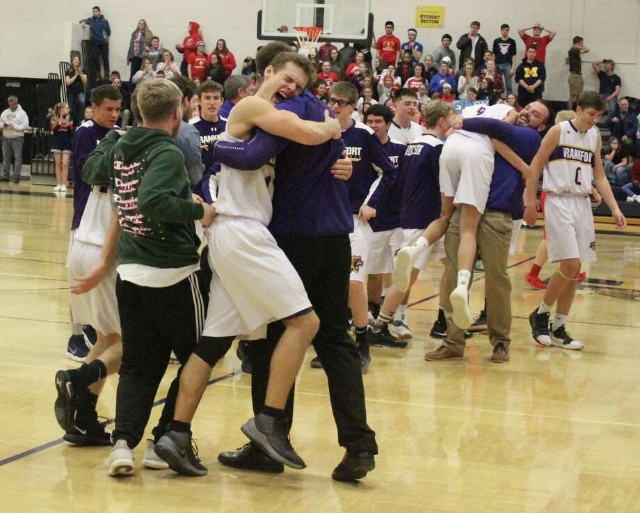 The Frankfort Panthers celebrate a trip to the Division 4 State Semifinals at the Breslin Center. (Photo/Robert Myers)