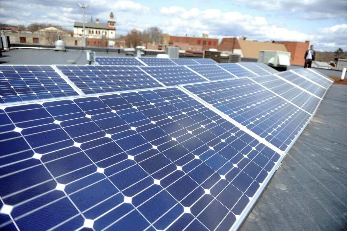 UIL Holdings donated and installed 18 solar panels on the roof of TEAM, Inc. in Derby, the nonprofit organization that distributes energy assistance to Connecticut's lower Naugatuck Valley area.