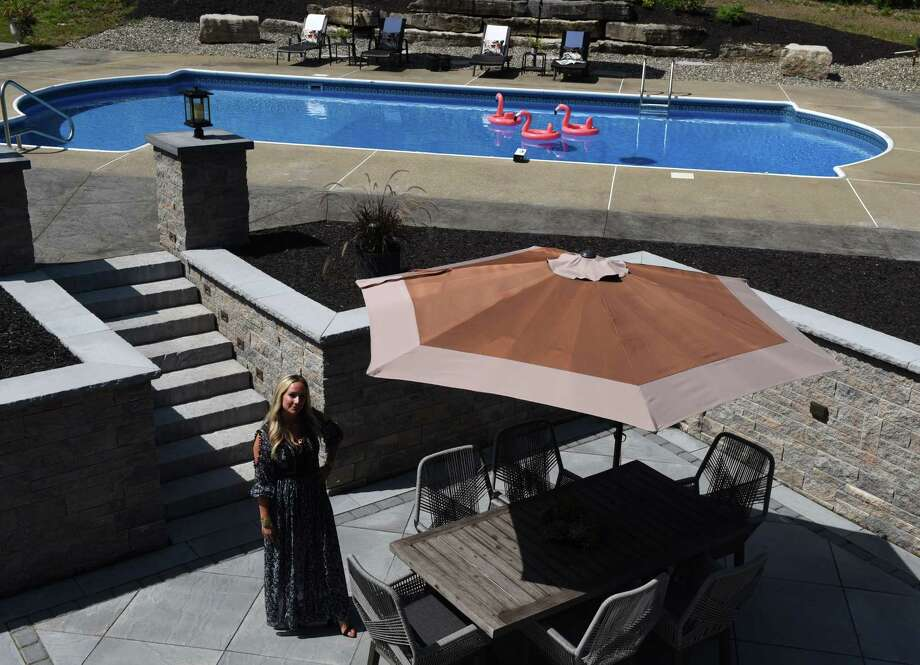 Diana Elkayam stands in her newly remodeled outdoor living space on Wednesday, Aug. 14, 2019, in Menands, N.Y. (Will Waldron/Times Union) Photo: Will Waldron / 20047655A