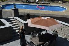 Diana Elkayam stands in her newly remodeled outdoor living space on Wednesday, Aug. 14, 2019, in Menands, N.Y. (Will Waldron/Times Union)