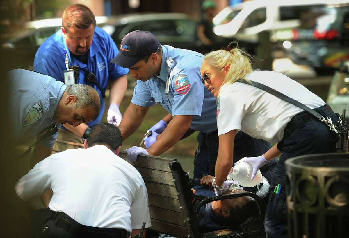 Paramedics and EMTs respond to one of three simultaneous drug overdose victims on the New Haven Green in New Haven, Conn. on August 16, 2018. Distribution of the illegal drug K-2 has resulted in a stream of overdoses, centered mainly on the Green.