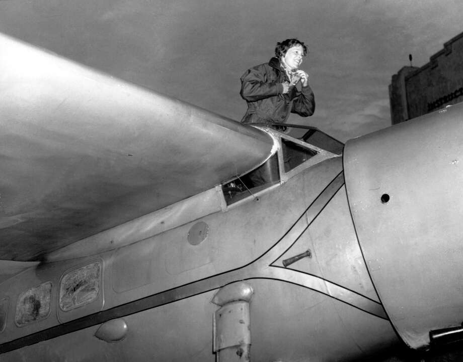 FILE - In this Jan. 13, 1935, file photo, American aviatrix Amelia Earhart climbs from the cockpit of her plane at Los Angeles, Calif., after a flight from Oakland to visit her mother. Robert Ballard, who discovered the Titanic, and a National Geographic expedition will search for Earhart's plane in August 2019 near a Pacific Ocean atoll named Nikumaroro, part of the Phoenix Islands. (AP Photo, File) Photo: AP / Copyright 1935 The Associated Press. All rights reserved.