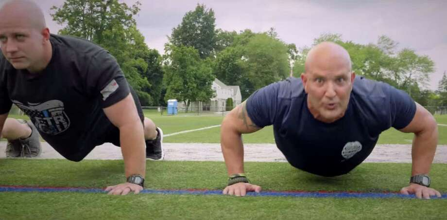 Screenshot from the Danbury Police Department's 2019 Recruitment Fitness Teaser —featuring Lt. Vincent Daniello, right — released Aug. 15, 2019. Photo: Danbury Police Department / Facebook