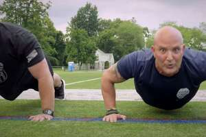 Screenshot from the Danbury Police Department's 2019 Recruitment Fitness Teaser —featuring Lt. Vincent Daniello, right — released Aug. 15, 2019.