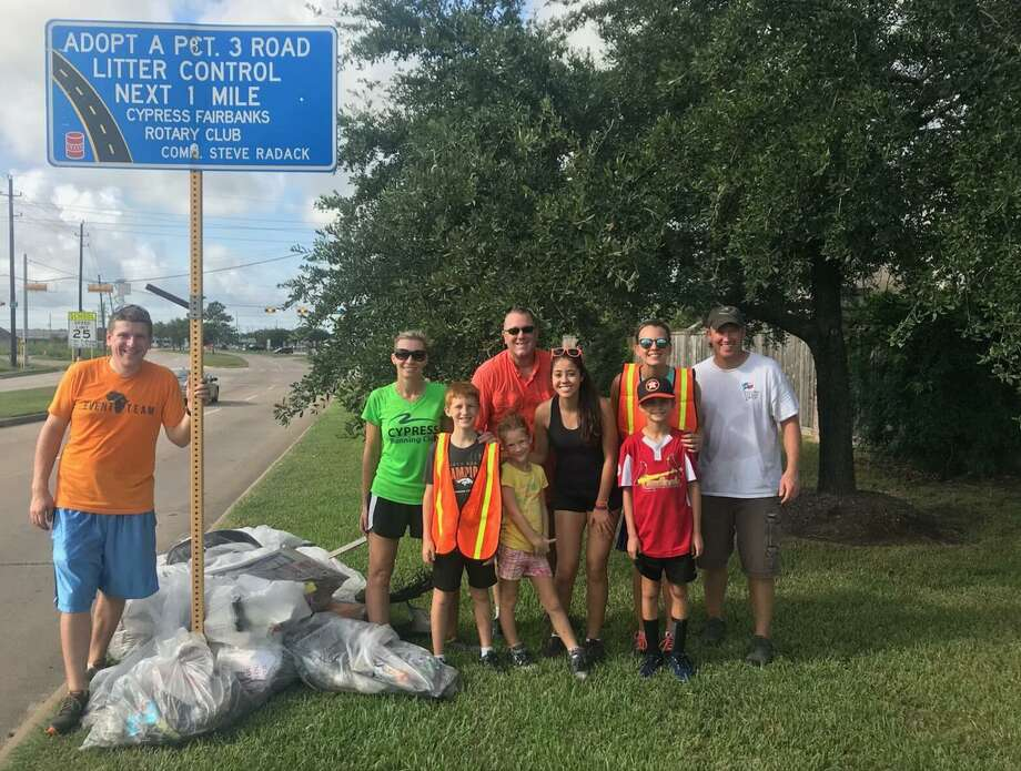 Rotary Club of Cypress-Fairbanks members, families and a Rotary Youth Exchange student collaborate to clean litter from a 1-mile stretch of Huffmeister Road as part of the Adopt a Pct. 3 Road Litter Control program. From left to right: Austin Blees; Angela Small; London Small; Jordan Small; Curtis LaMontagne; exchange student Maria Mendes Ferreira; Britni Davison; Robby Davison; Troy Small. Photo: Courtesy Of Rotary Club Of Cypress-Fairbanks