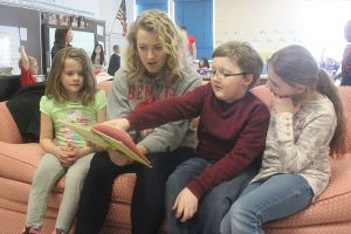 Benzie Central senior Mary Claire Smeltzer spends time reading with Betsie Valley Elementary first graders during National Reading Month.
