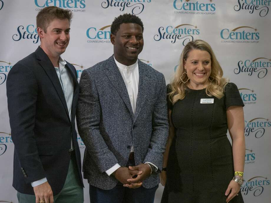 LaDainian Tomlinson takes a picture with William and Anne Reese 08/15/19 at the 19th annual Centers Stage presents an Evening with LaDainian Tomlinson. Tim Fischer/Reporter-Telegram Photo: Tim Fischer/Midland Reporter-Telegram