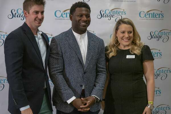 LaDainian Tomlinson takes a picture with William and Anne Reese 08/15/19 at the 19th annual Centers Stage presents an Evening with LaDainian Tomlinson. Tim Fischer/Reporter-Telegram