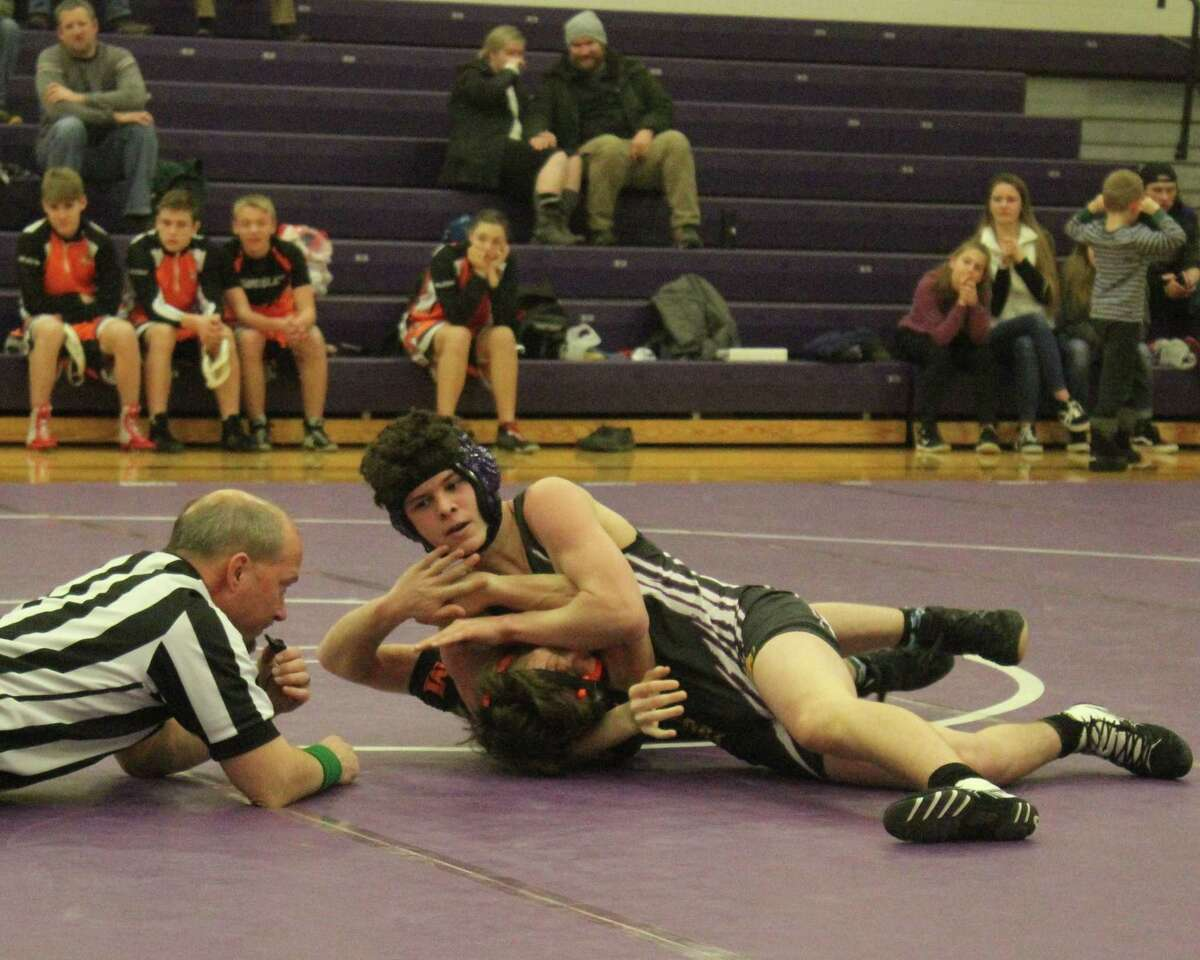 Jared Coxe works to pin his opponent from Mancelona during a home tri-match on Jan. 3. (Photo/Robert Myers)