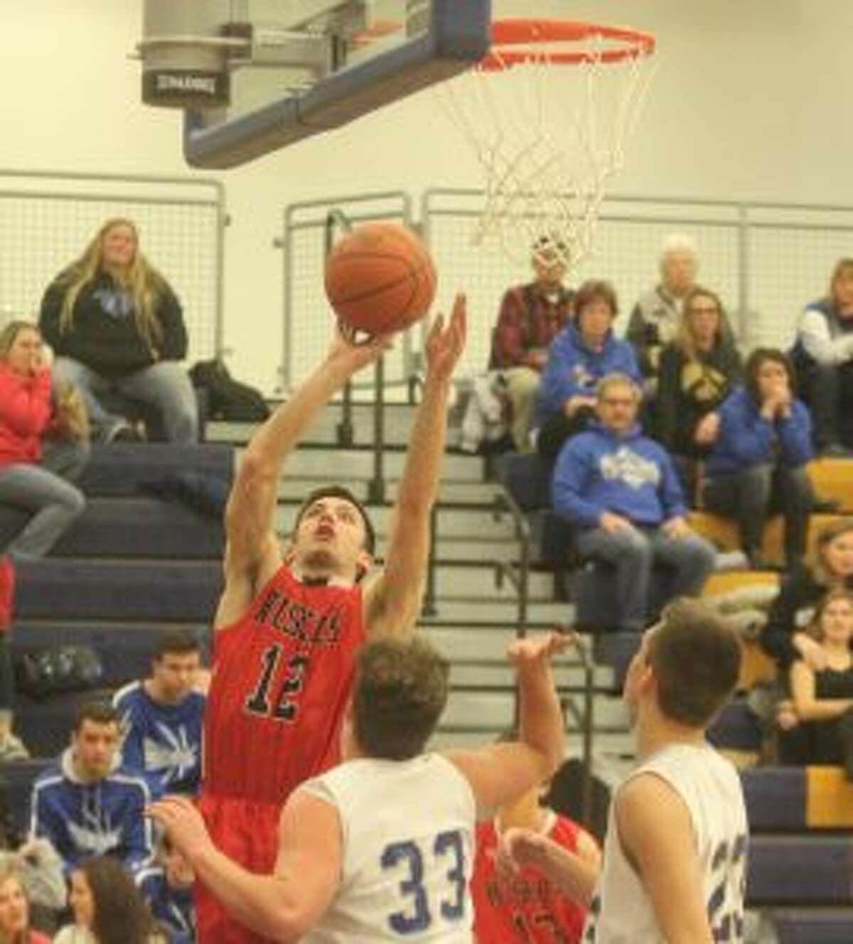 Tom Ross goes up for a layup in a loss to the Portagers. (Photo/Robert Myers)