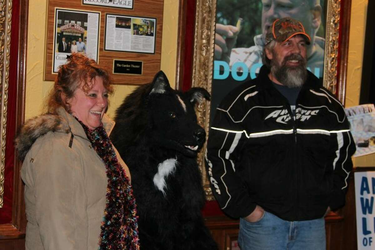 """FRIENDLY: The usually illusive Dogman lets moviegoers pose with it for a picture during the sneak-peek showing of """"Dogman 2: Wrath of the Litter"""" at the Garden Theater in Frankfort Friday."""