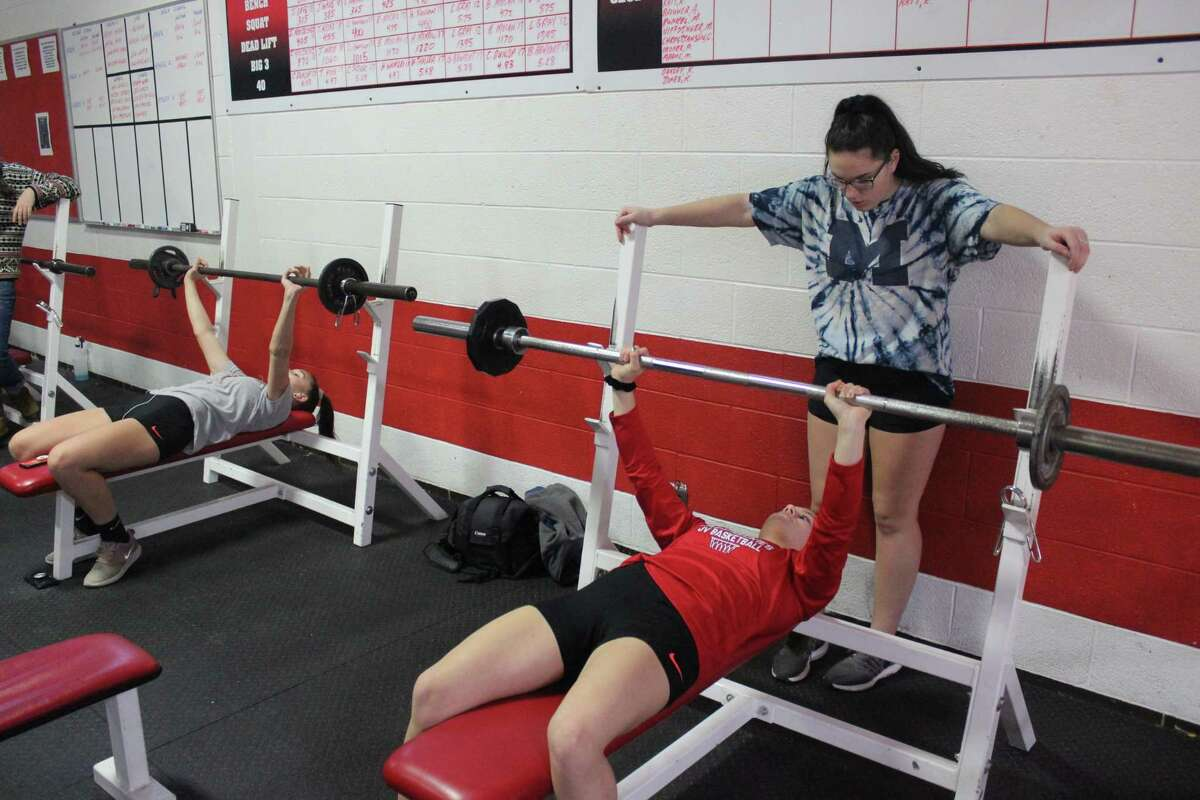 Twice a week, girls in the ATHENA program enjoy weightlifting with each other after school. (Photo/Robert Myers)