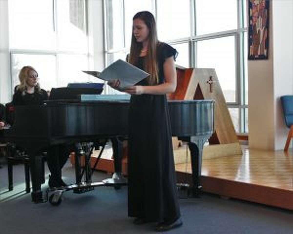 "Bella Huddleston performs her solo ""Amazing Grace."" (Photo/Robert Myers)"