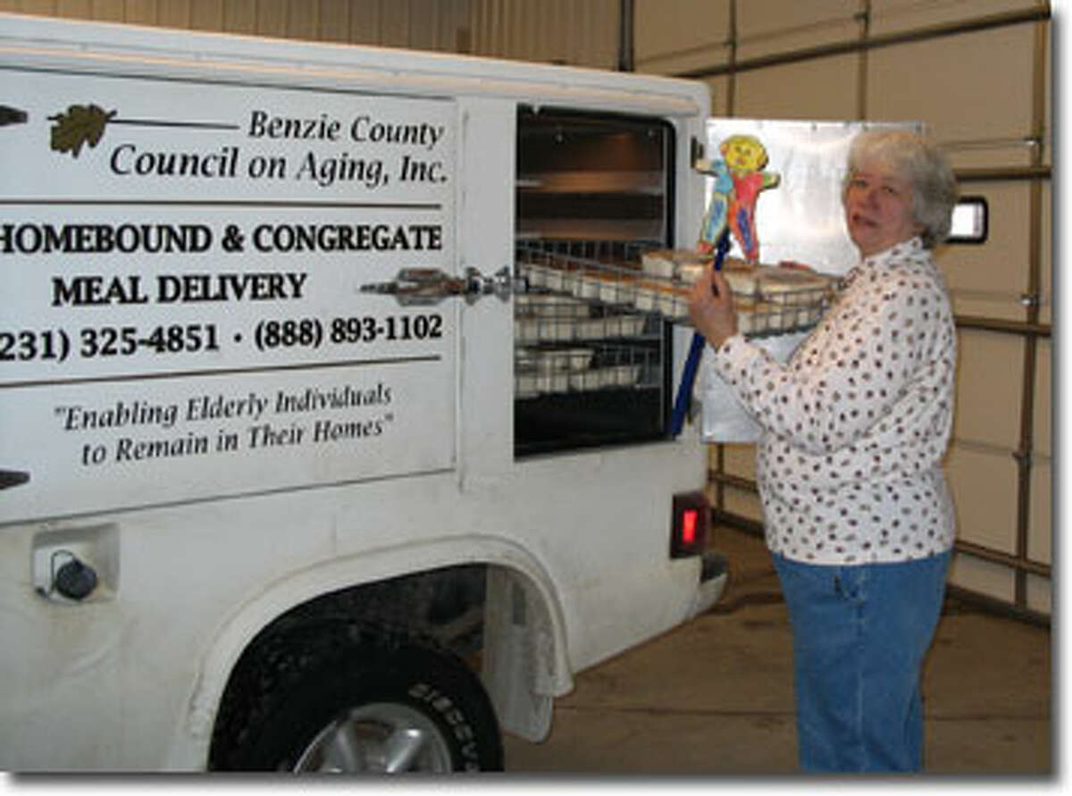 DELIVERY: An employee for the Benzie County Commission on Aging loads home-delivered meals onto a truck for delivery. (Courtesy Photo)