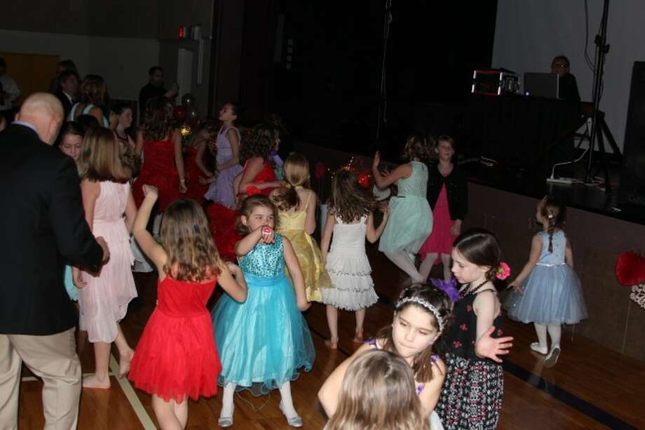 DANCE TIME: Girls at the Daddy Daughter Dance get down with each other and their dads while the DJ plays popular music and music videos.