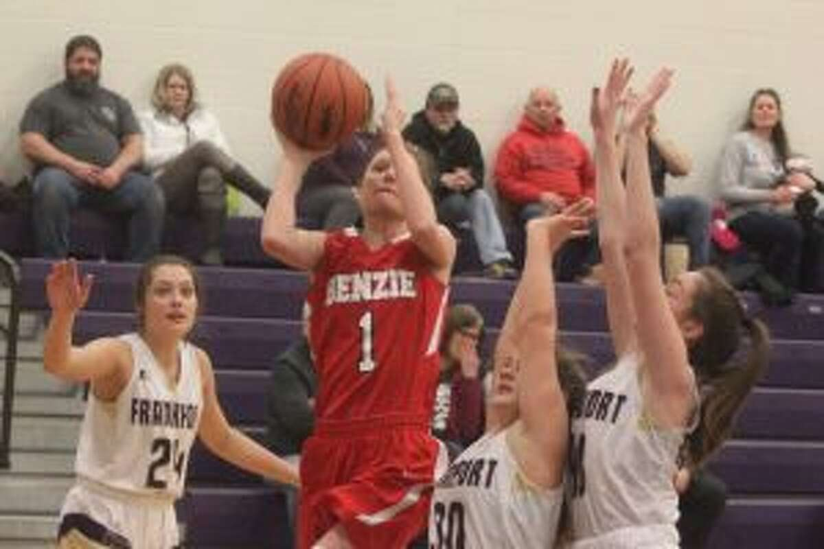 Ellen Bretzke drives for layup in what was a 17-point effort for the Benzie Central sophomore. (Photo/Robert Myers)