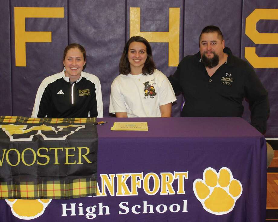 Wooster assistant women's basketball coach Nicole Marshall (left) and Frankfort girls basketball coach Tim Reznich (right) celebrate Riley Thorr's (middle) decision to play college basketball at Wooster. (Photo/Robert Myers)