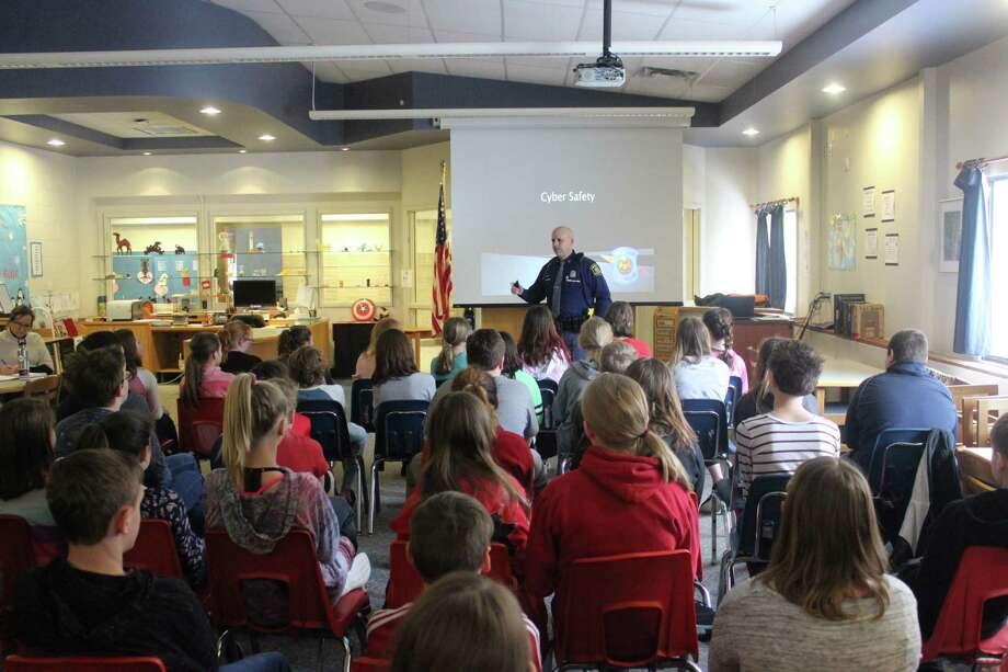 State Police Trooper Dave Prichard talks to Frankfort Elementary sixth grade students about cyber safety. (Photo/Robert Myers)