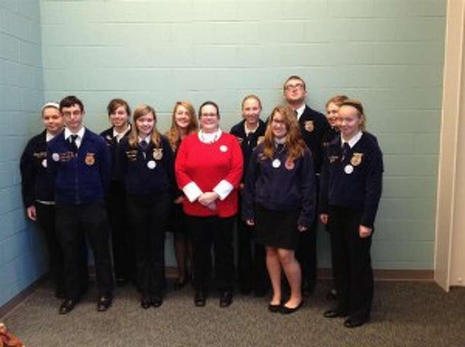 FFA LEADERSHIP: Members of the Benzie FFA had a busy time, taking part in the Leadership Convention and competitions. Pictured left to right are Miranda Egeler, Charlie LaPan, Blaire Frederick, Jessica Brian, Kristen Hawkins, adviser Melinda Klockziem, Zoey Reightley, Samantha Lanham, Taylor Dyer, Elizabeth Putney and Katelyn Nordbeck. (Courtesy photo)