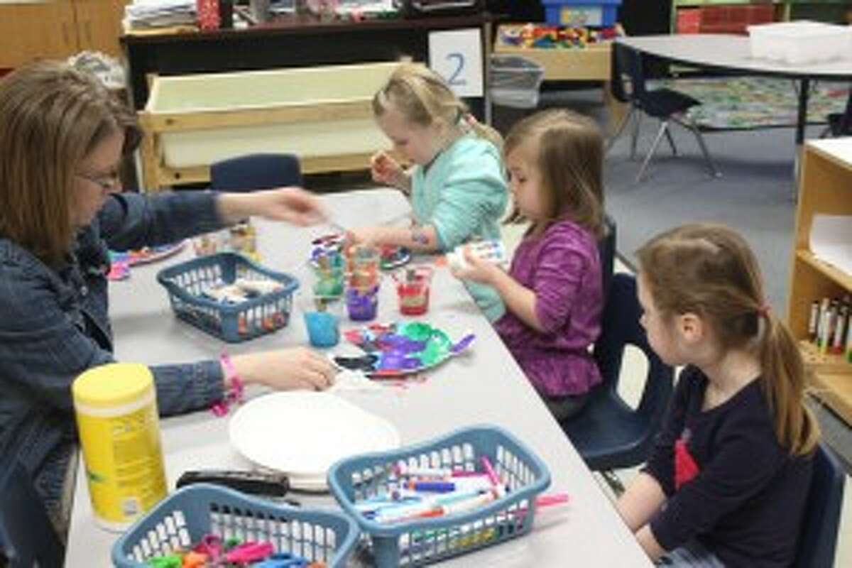 PAINTING THE FISH: Students in the Crystal Lake Co-op Preschool work hard on their crafts during class. The program gives the students a chance to have fun while also learning. It helps in the transition into kindergarten the following year.