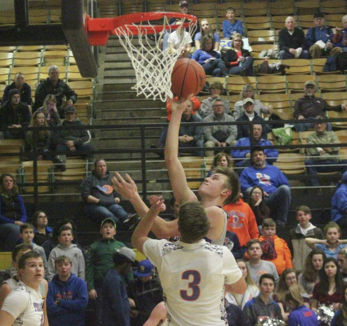 Will Newbold scores on a transition layup in the first half of Frankfort's rout of Central Lake. (Photo/Robert Myers)