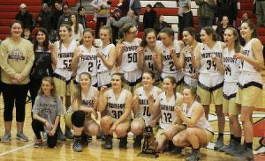 Frankfort's girls basketball team celebrates its sixth straight district championship. (Kyle Kotecki/Pioneer News Network)