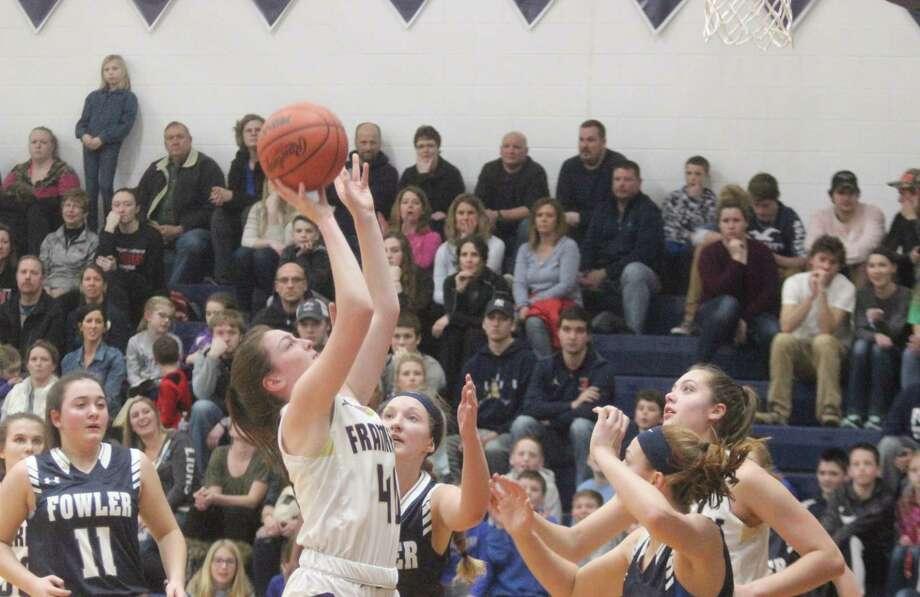Emily Loney tries to go back up with the ball after grabbing an offensive rebound. (Photo/Robert Myers)