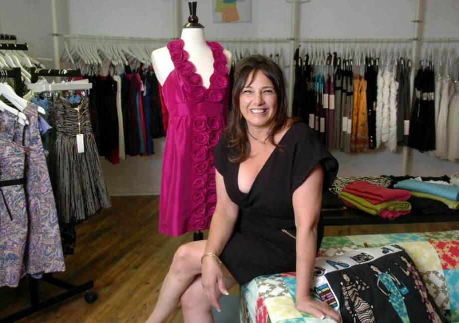 Owner Mary Perkins sits in the showroom of her new boutique Dress Code at 578 Post Rd. East in Westport Thursday July 29, 2010. Photo: Autumn Driscoll / Connecticut Post