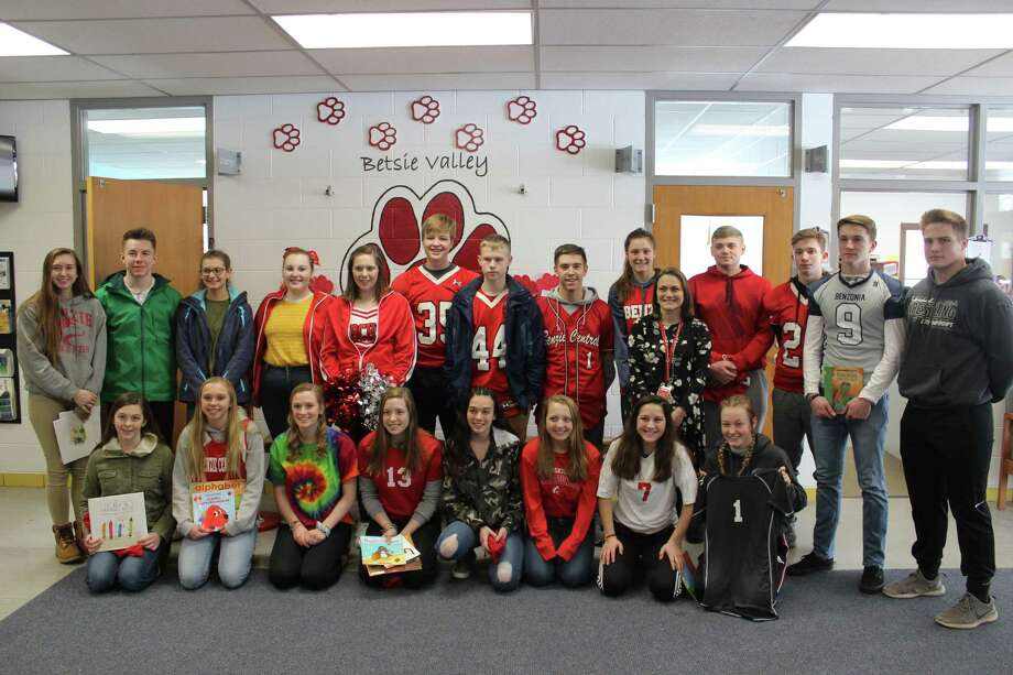 Benzie Central high school students athletes visit Betsie Valley Elementary to read to students and talk to them about life at the high school. (Photo/Robert Myers)