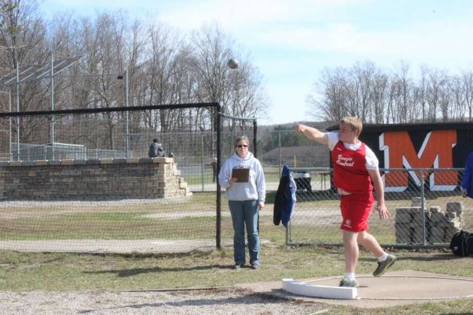 FRESHMEN POWER: Benzie Central freshman Ramsey Blough competes in the shot put for the Huskies track team.