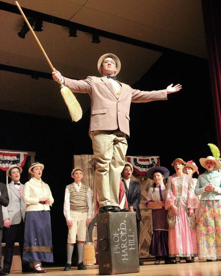 The Music Man (Brandon Tinker) gets the town of River City riled about over the evils of pool tables. (Photo/Robert Myers)