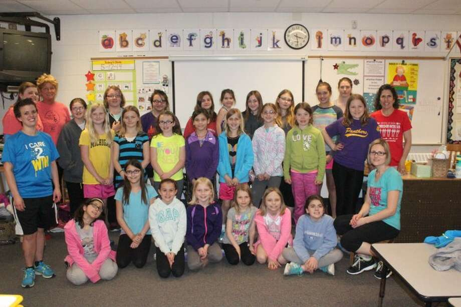 BRINGING THE POSITIVE IMAGE: The Frankfort Girls on the Run group works to help students learn healthy choices and have a positive self-image. (Photo/Bryan Warrick)