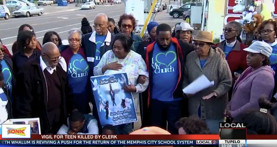 Dorian Harris's grandmother, Effie Fitch, center, honors Harris at a vigil at the Top Stop Shop last year Photo: Local Memphis