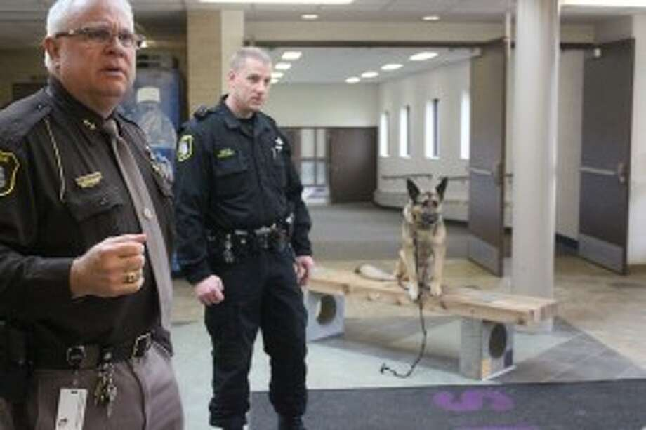 SEARCH: Benzie County sheriff Ted Schendel organizes the K-9 units at Frankfort High School during a drug search. Both Frankfort and Benzie Central schools were searched. (Photo/Bryan Warrick)
