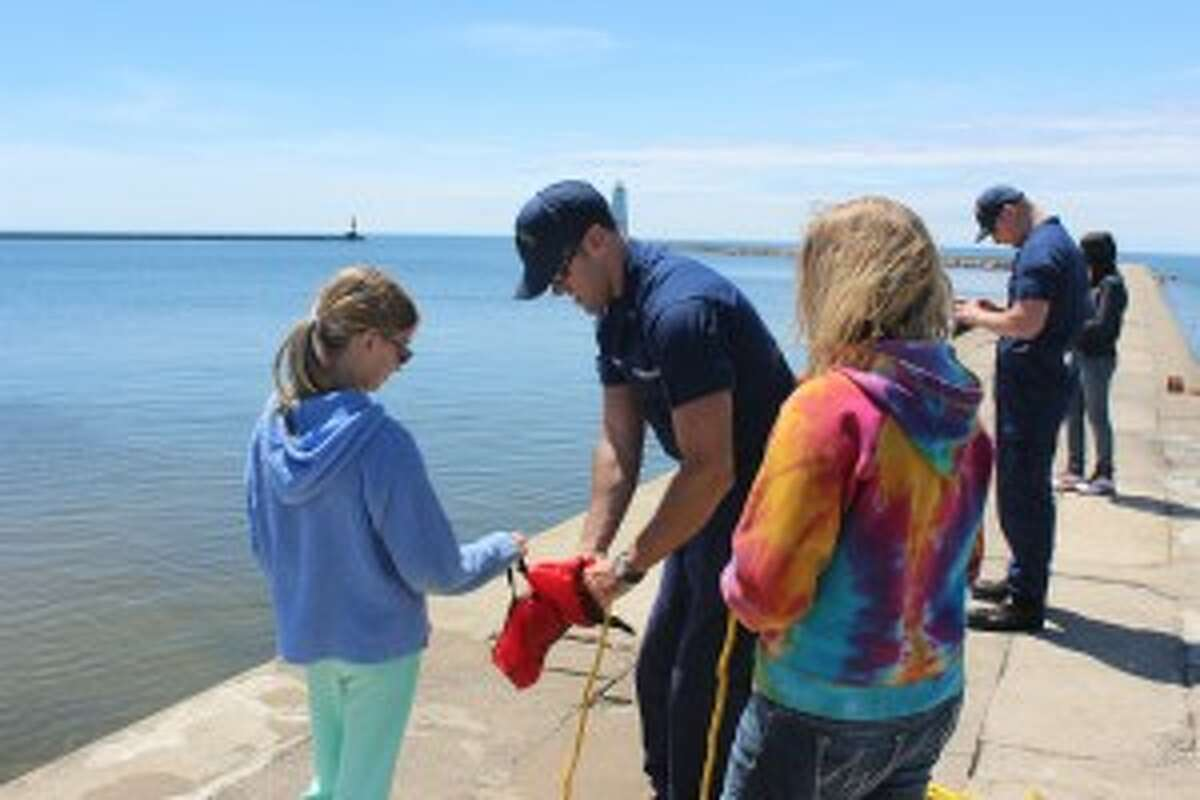 LEARNING THE EQUIPMENT: Students from Frankfort Elementary learn some of the different safety and rescue equipment from coast guard servicemen. (Photo/Bryan Warrick)