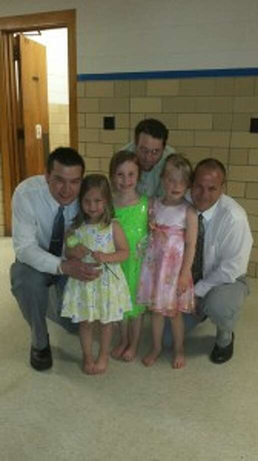 LOVED ONES: For the first annual Daddy Daughter Dance at Crystal Lake Elementary, girls brought their fathers or another special adult male in their lives.