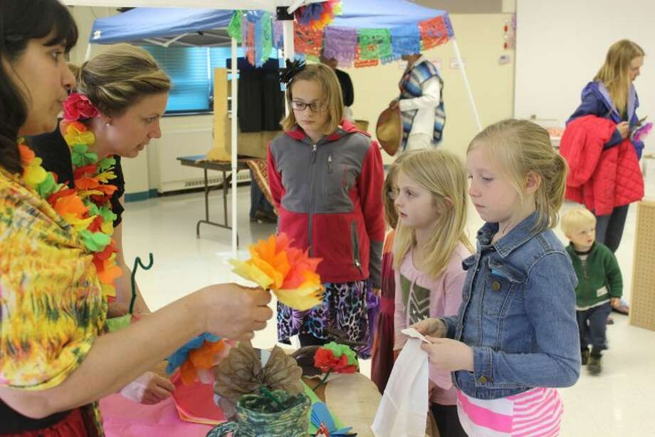 MAKING A FLOWER: The students at the fiesta event at Frankfort Elementary School were able to take home a paper flower they made themselves.