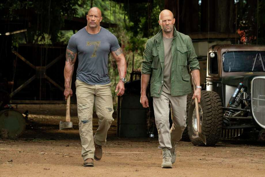 "This image released by Universal Pictures shows Dwayne Johnson, left, and Jason Statham in a scene from ""Fast & Furious Presents: Hobbs & Shaw."" Movie going audiences have helped the ""Fast & Furious"" spinoff ""Hobbs & Shaw"" take another lap at No. 1 even with the onslaught of new movies this weekend. Universal Pictures estimated Aug. 11 that ""Hobbs & Shaw"" added $25.4 million from North American theaters, bringing its domestic total to $108.5 million. Photo: Frank Masi / Associated Press / COPYRIGHT ©2019 UNIVERSAL STUDIOS"