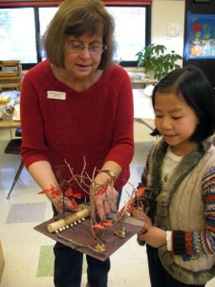 HELPING HAND: Environmental artist and Michigan Legacy Art Park education director,Patricia Innis points out to Mary-Katherine MacRAE things she likes most about the 3 D model. (Courtesy Photo)
